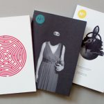 Colour, three 'No.' zine issues. Photograph of a woman in face and head covering, red drawing of a circular labyrinth and collage consisting of photograph of a man smoking pipe and black line flower like symbol over his face.