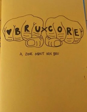 'BruXcore' zine cover. Black line drawing of knuckle tattoos of the zine title. Light orange background.