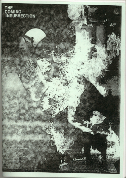 """Black and white """"The coming insurrection"""" zine cover. Photograph of protestors and fire with small printed title text, on green paper."""