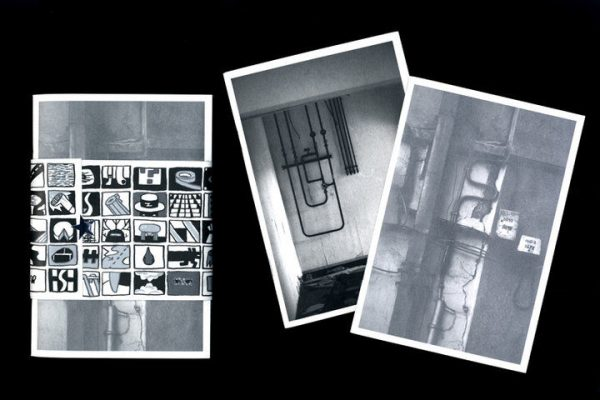"""""""Photographique"""" issue 2 zine. 3 black and white photographs showing interiors with exposed pipes and wiring. The first photograph is wrapped in a paper band  with hand drawn cartoons."""