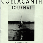 """Black and white """"the Coelacanth journal"""" issue 5 zine cover. Photograph of a big fish being pulled out of a body of water. Bold printed title at the top."""