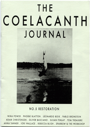 """Black and white """"the Coelacanth journal"""" issue 5 zine cover. Photograph of a big fish in mid air being pulled from a body of water. Bold printed title at the top."""