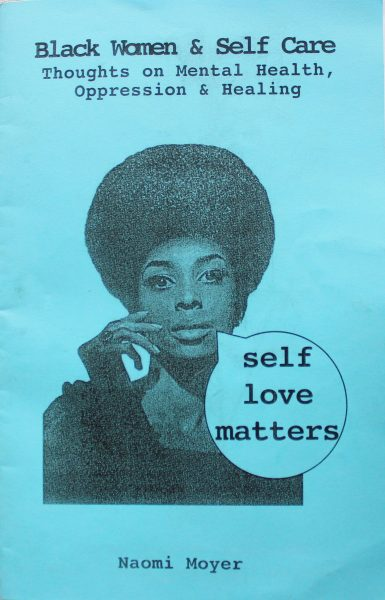 """Blue cover of zine showing title """"Black women & self care. Thoughts on mental health, oppression & healing"""" and image of black woman with a dialogue bubble that says """"self love matters""""."""