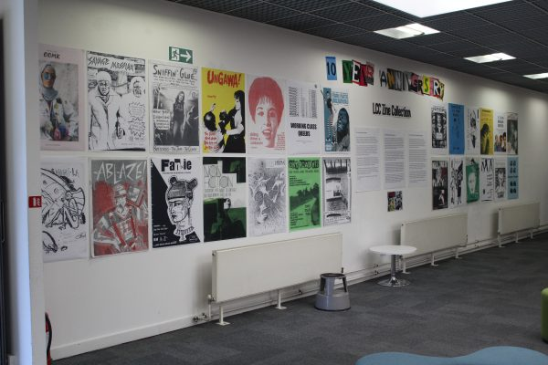 Image of a wall display of enlarged zine covers in the Library at London College of Communication.