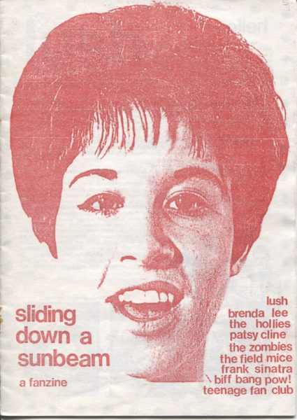 Cover image of Sliding down a sunbeam: a fanzine. Red printed face of Helen Shapiro. List of music bands: Lush, Brenda Lee, The Hollies, Patsy Cline, The Zombies, The Field Mice, Frank Sinatra, Biff Bang Pow!, Teenage Fan Club.
