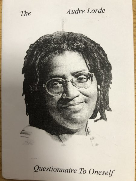 Cover image zine.  Text in black reads The Audre Lorde Questionnaire to Oneself. Image of Audre Lorde smiling with glasses and mid length dreadlocks. Printed on cream paper.